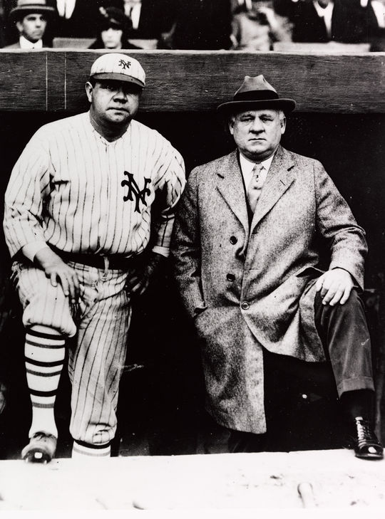 """Babe Ruth (pictured left) poses with manager John McGraw before taking the field for the New York Giants for a charity benefit game against the Baltimore Orioles on Oct. 3, 1923. (National Baseball Hall of Fame and Museum) <a href=""""https://collection.baseballhall.org/islandora/object/islandora%3A611028"""">PASTIME</a>"""