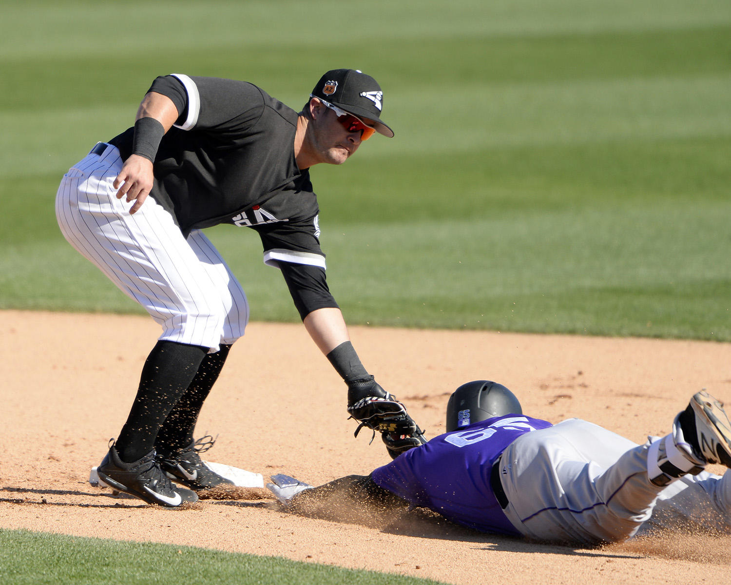 Eddy Alvarez makes a tag at second base during the White Sox's Spring Training camp in Glendale, Ariz. (Ron Vesely/National Baseball Hall of Fame and Museum)
