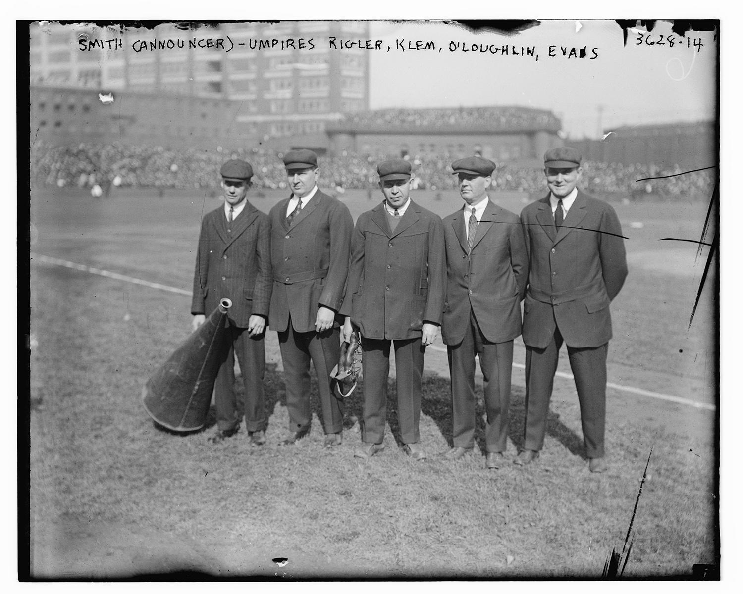 From left to right at the 1915 World Series: An unidentified Philadelphia Phillies announcer with umpires Cy Rigler, Bill Klem, Silk O'Loughlin and Billy Evans. O'Loughlin, a well-respected MLB umpire, fatally contracted influenza during the 1918 pandemic. (Photo courtesy of Library of Congress)