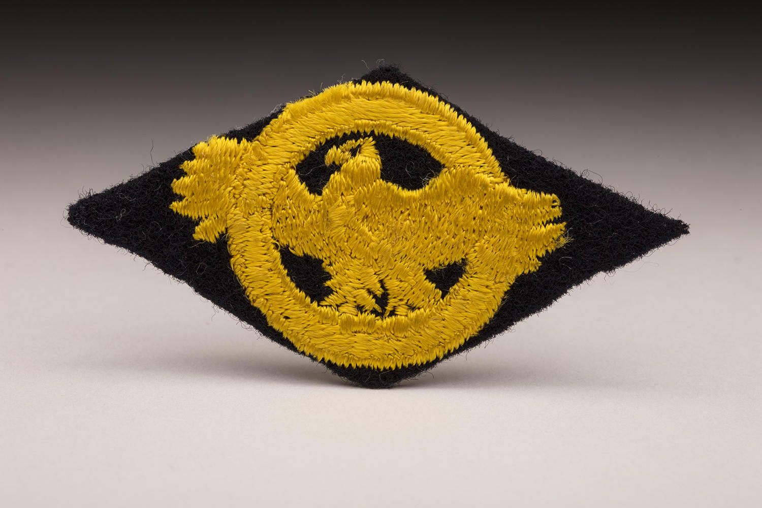 "The ""ruptured duck"" patch (pictured above) was a source of pride for returning ballplayers who served in World War II. (By Photographer Milo Stewart Jr./National Baseball Hall of Fame and Museum)"