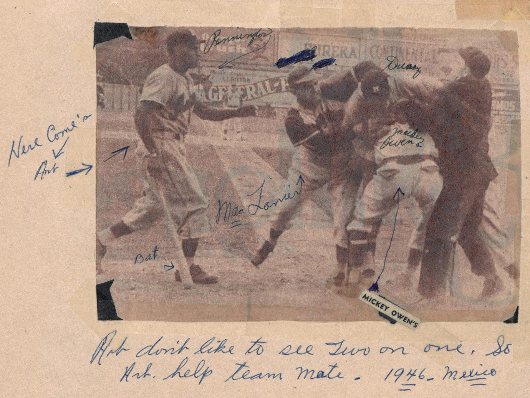 """Pennington has annotated his scrapbook throughout.  Under this photo clipped from a newspaper, Pennington's caption reads, """"Art don't like to see two on one. So Art help team mate.  1946 - Mexico.""""  Arrows further identify Pennington, Max Lanier, Mickey Owens, and Claro Duany.  Pennintgon has also pointed an arrow to """"Bat"""" and """"Here come's [sic] Art.""""   BA-SCR-2-025   (National Baseball Hall of Fame)"""