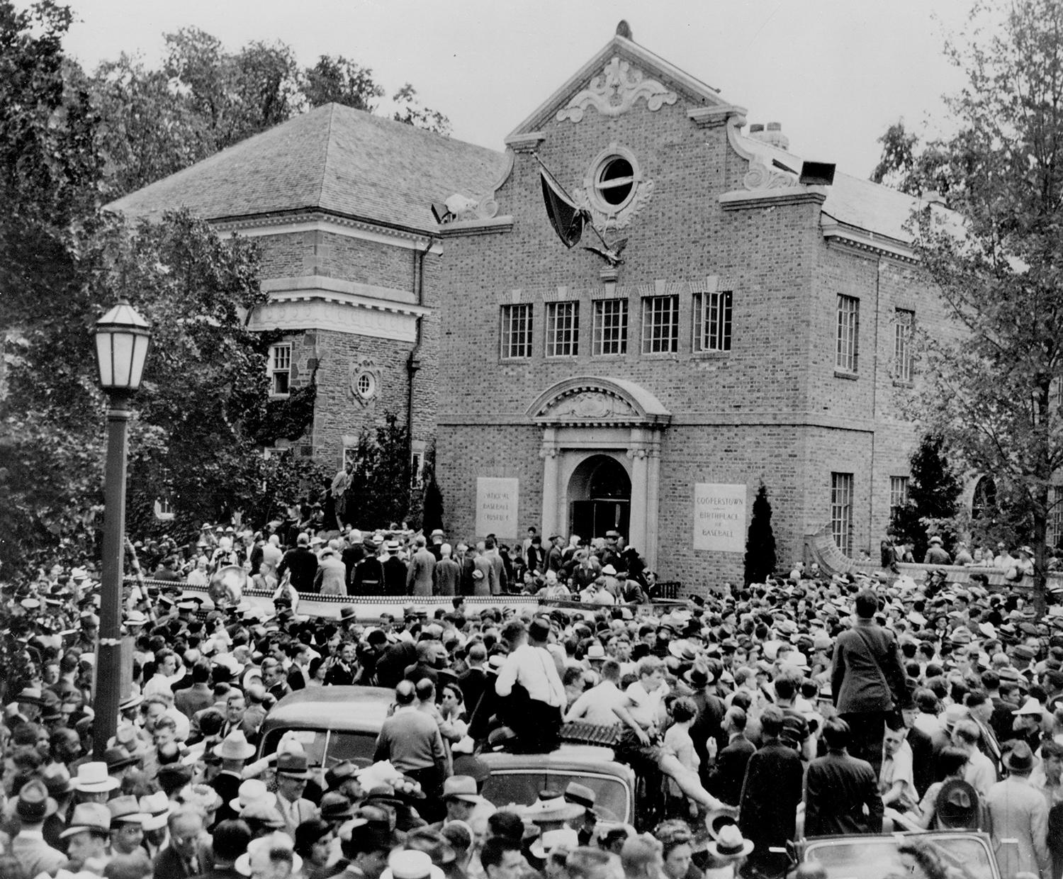 Fans gather in front of the Hall of Fame on June 12, 1939 for the first induction ceremony. (Homer Osterhoudt/National Baseball Hall of Fame and Museum)