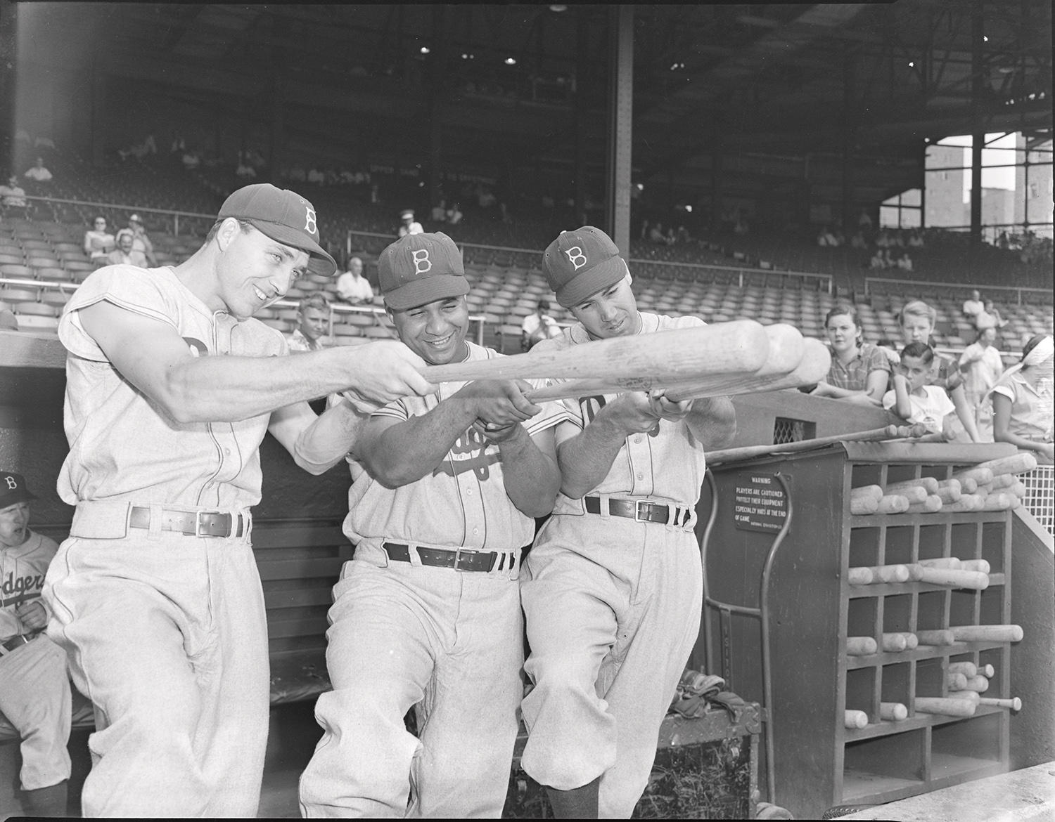 """Gil Hodges (left), Roy Campanella (center), and Duke Snider (right) pose together, holding up their bats as if they were rifles. <a href=""""https://collection.baseballhall.org/islandora/object/islandora%3A627453"""">PASTIME</a> (Osvaldo Salas/National Baseball Hall of Fame and Museum)"""