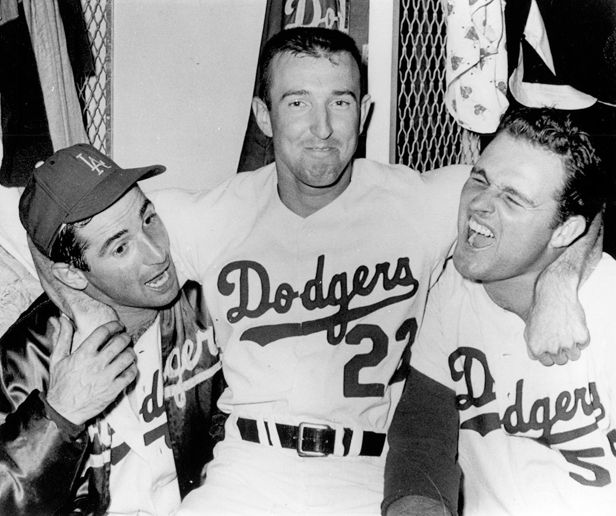 Claude Osteen (center) celebrates with Don Drysdale (right) and Sandy Koufax (left) after Sandy leads the Dodgers to a 7-0 victory over the Minnesota Twins in Game 5 of the 1965 World Series. (National Baseball Hall of Fame and Museum)