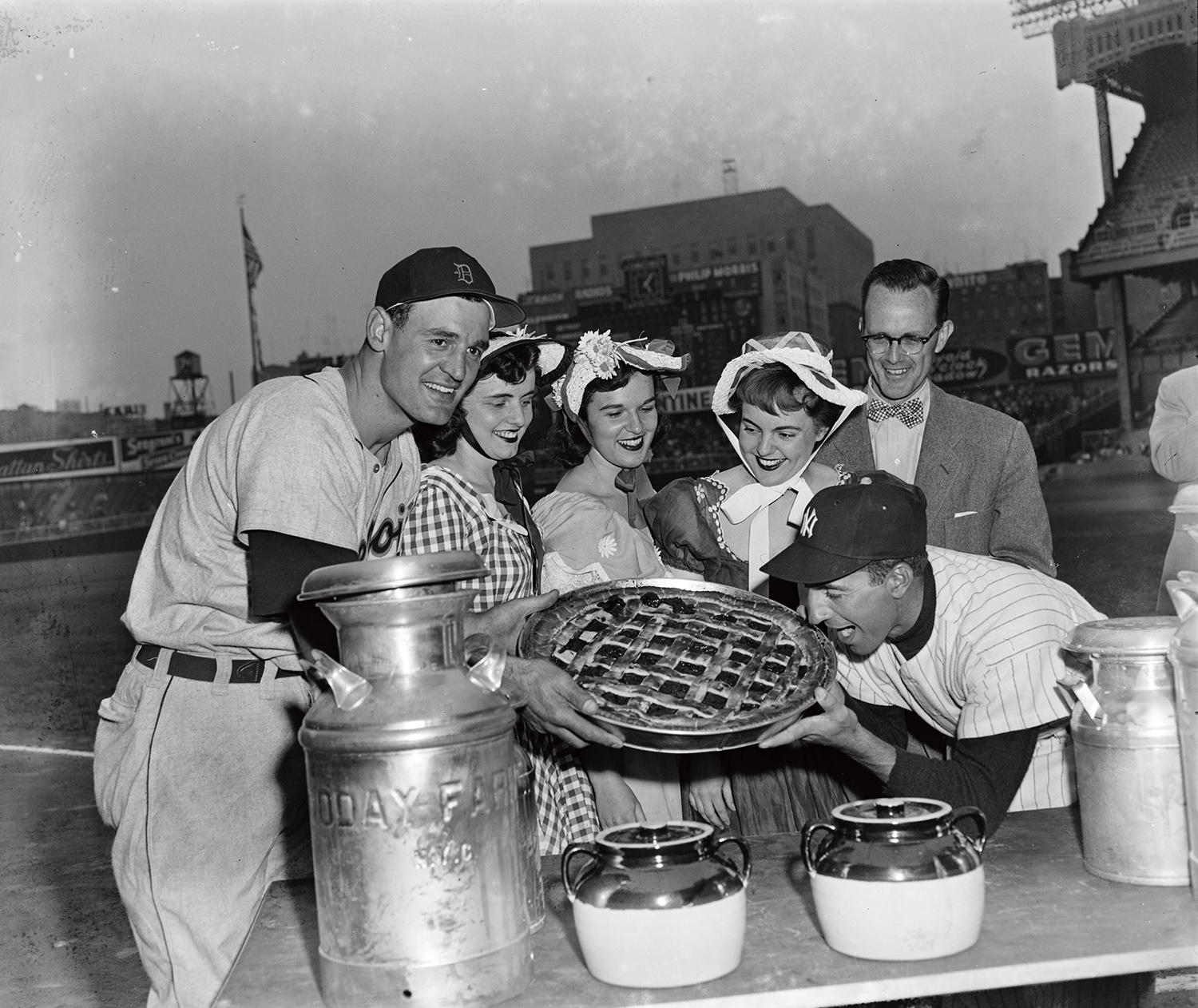 """Future Hall of Famer Phil Rizzuto pretends to take a bite of a big pie while on-field at Yankee Stadium in the 1950s. <a href=""""https://collection.baseballhall.org/islandora/object/islandora%3A630885"""">PASTIME</a> (Osvaldo Salas/National Baseball Hall of Fame and Museum)"""
