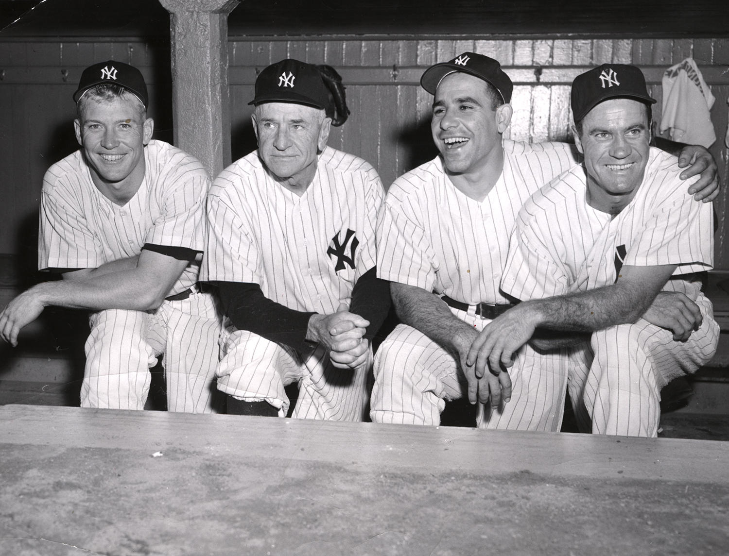 Casey Stengel was at the helm of the New York Yankees from 1949-1960, leading them to 10 pennants and seven World Series titles. From left, Mickey Mantle, Stengel, Yogi Berra and Hank Bauer pose in the dugout.(National Baseball Hall of Fame and Museum)