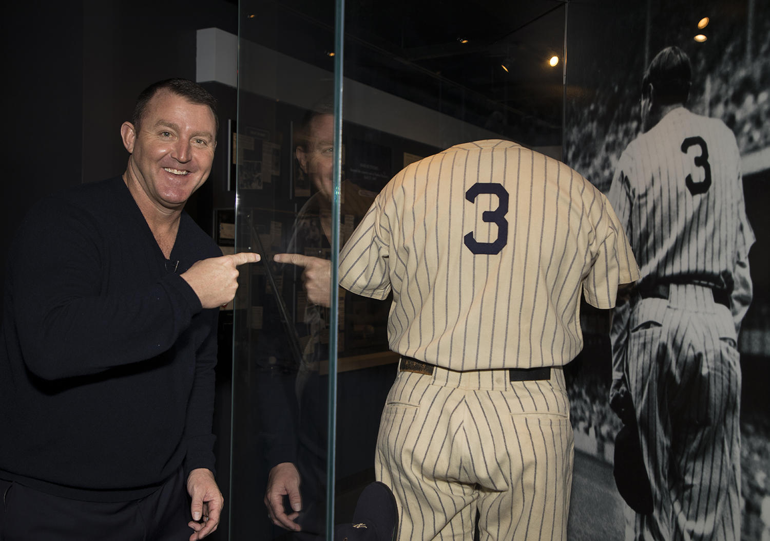Jim Thome motions toward Babe Ruth's jersey on exhibit in the Museum during his Orientation Visit. (Milo Stewart Jr./National Baseball Hall of Fame and Museum)