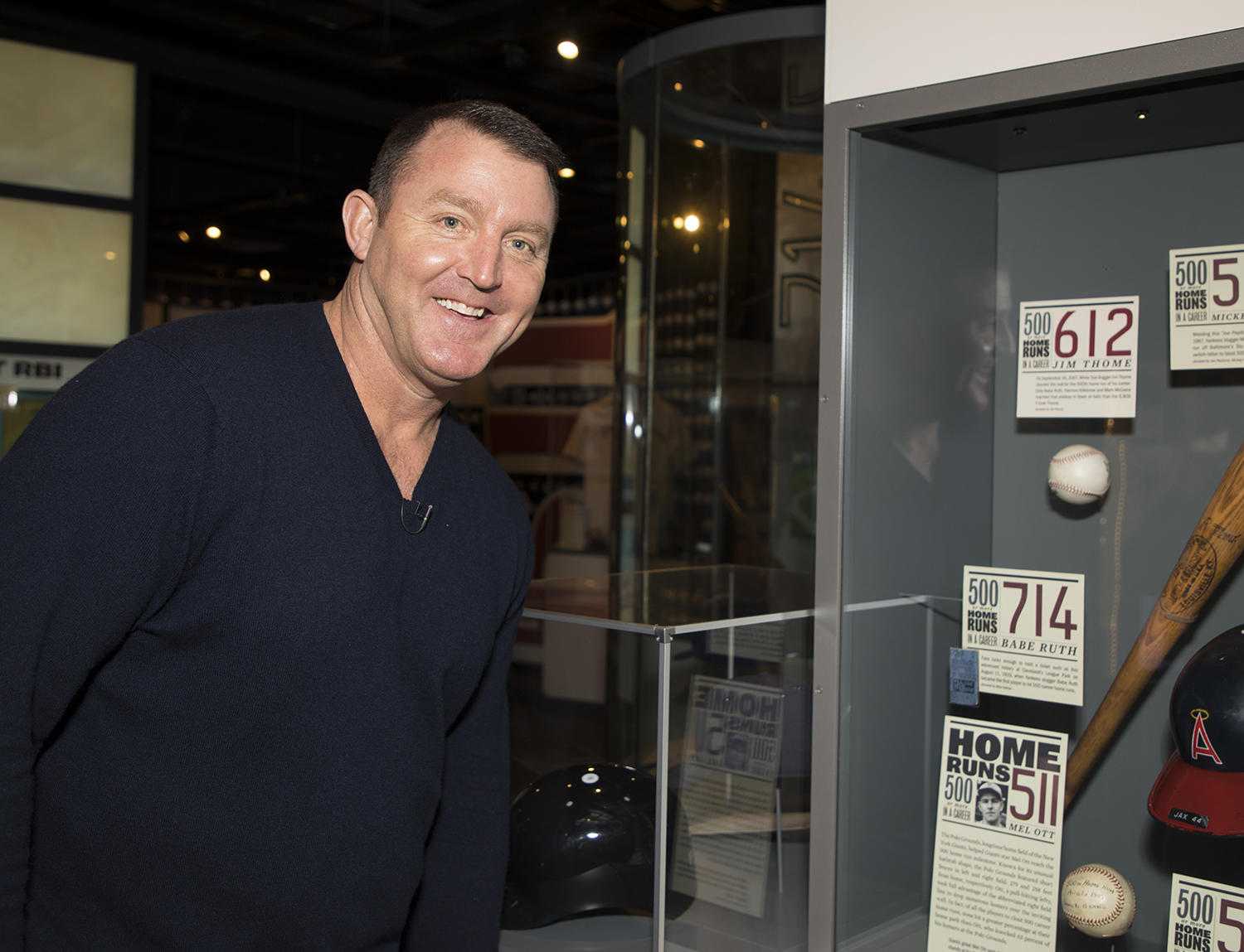 Jim Thome poses next to the baseball he hit for his 500th home run, on display in the Museum. (Milo Stewart Jr./National Baseball Hall of Fame and Museum)