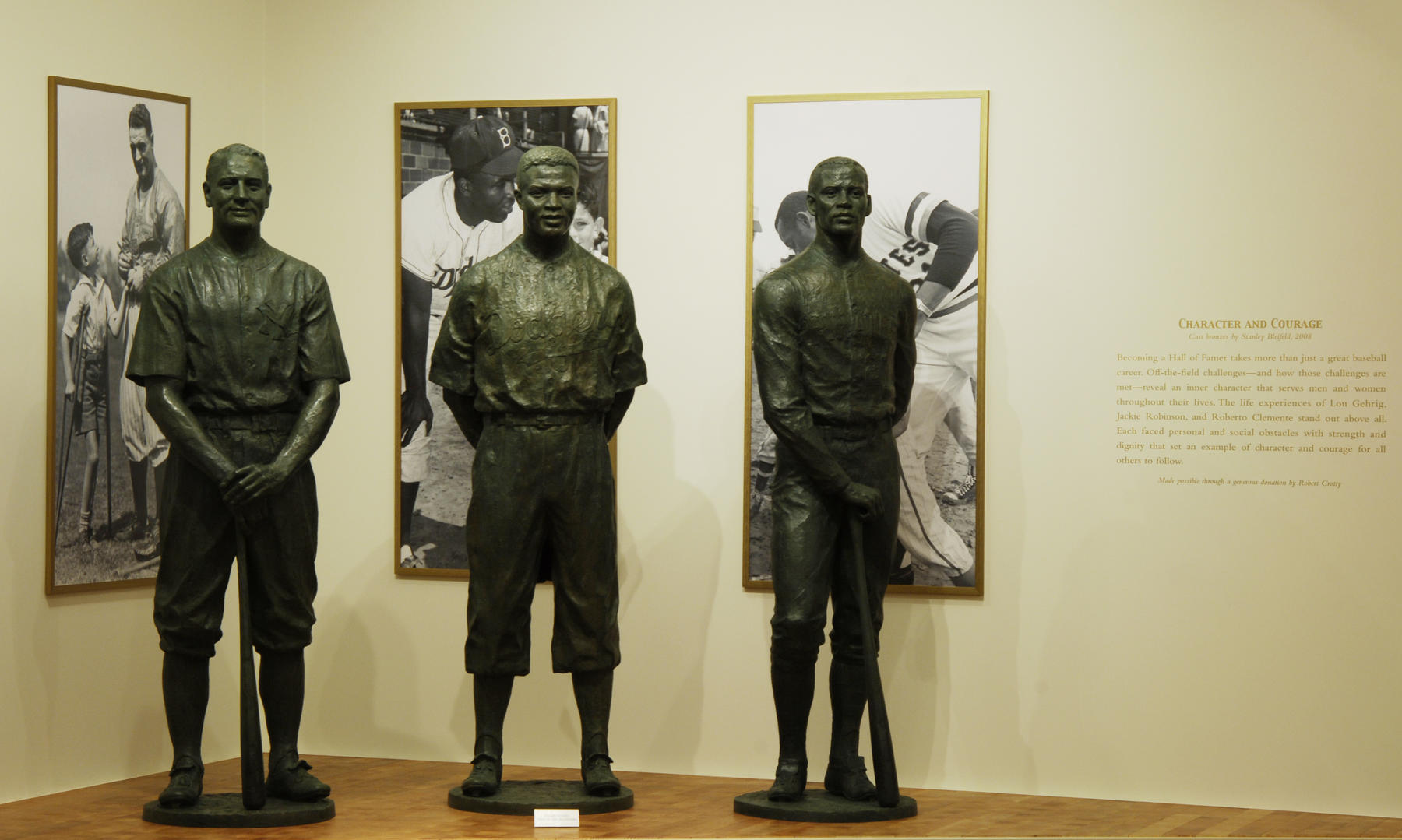 Three larger-than-life statues of Hall of Fame Members Lou Gehrig, Jackie Robinson and Roberto Clemente, located in the Museum's foyer, represent character and courage in baseball and in life. (By Photographer Milo Stewart Jr./National Baseball Hall of Fame and Museum)