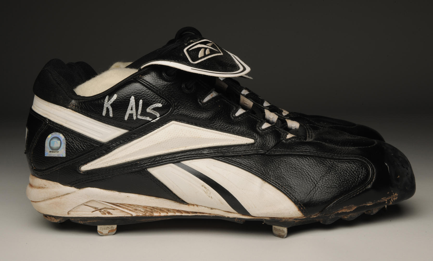 "Curt Schilling's right cleat worn during the 2004 World Series with ""K ALS"" written in silver marker. B-337.2004 (Milo Stewart Jr. / National Baseball Hall of Fame and Museum)"