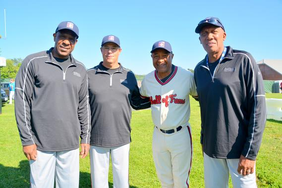 Hall of Famers Andre Dawson (left), Greg Maddux, Ozzie Smith and Ferguson Jenkins pose for a photo during the 14th annual PLAY Ball event Friday morning at Clark Sports Center in Cooperstown. PLAY Ball, which Smith has hosted since his Hall of Fame Induction in 2002, raised nearly $40,000 this year for the Museum's educational programs and  Frank and Peggy Steele Internship scholarships. (Ben Platt / MLB.com)