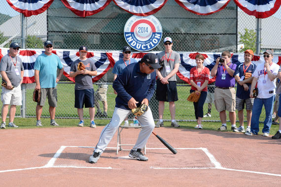 Hall of Fame catcher Johnny Bench works out at home plate during the 2014 PLAY Ball program. Bench is one of many Hall of Famer guests that host Ozzie Smith has brought to PLAY Ball since 2002. (Milo Stewart Jr./National Baseball Hall of Fame)