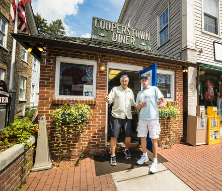 Goose Gossage (right) and Rollie Fingers stop for a quick bite at the Cooperstown Diner during Hall of Fame Weekend. (Jean Fruth / National Baseball Hall of Fame and Museum)