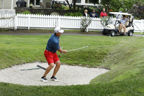 Chipper Jones chips out of a sand trap during the Hall of Fame Weekend Golf Tournament at Leatherstocking Golf Course in Cooperstown. Jones' team finished second in the tournament behind a team led by Wade Boggs. (Milo Stewart Jr./National Baseball Hall of Fame and Museum)