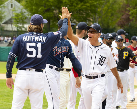 Alan Trammell (right) and Trevor Hoffman share a high five during introductions at the 2019 Hall of Fame Classic in Cooperstown. (Milo Stewart Jr./National Baseball Hall of Fame and Museum)