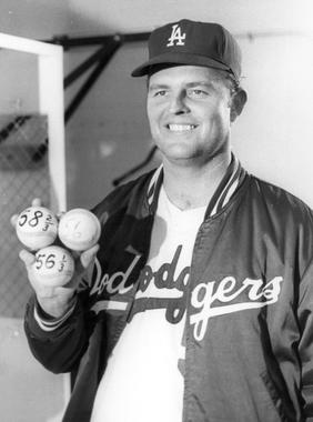 Los Angeles Dodgers pitcher Don Drysdale threw 58 and 2/3 consecutive scoreless innings during the summer of 1968 to eclipse the all-time record of 56 scoreless frames set by fellow Hall of Famer Walter Johnson in 1913. All three of the baseballs Drysdale holds in this picture are housed in the Hall of Fame collection. BL-1368-68 (National Baseball Hall of Fame Library)