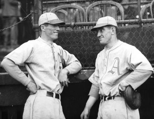 Lefty Grove (left) talks to fellow future-Hall of Famer Mickey Cochrane while they were teammates for the Philadelphia Athletics. (National Baseball Hall of Fame)