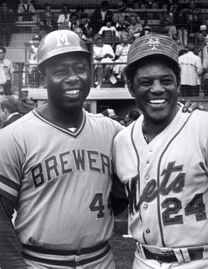 Future Hall of Famers Hank Aaron of the Brewers and Willie Mays of the Mets are all smiles at Doubleday Field on Aug. 9, 1976. (National Baseball Hall of Fame and Museum)