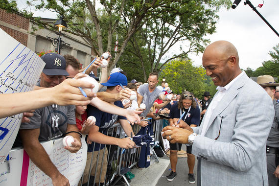 Mariano Rivera signs autographs during the July 20, 2019, <em>Parade of Legends</em> in Cooperstown. (Milo Stewart Jr./National Baseball Hall of Fame and Museum)