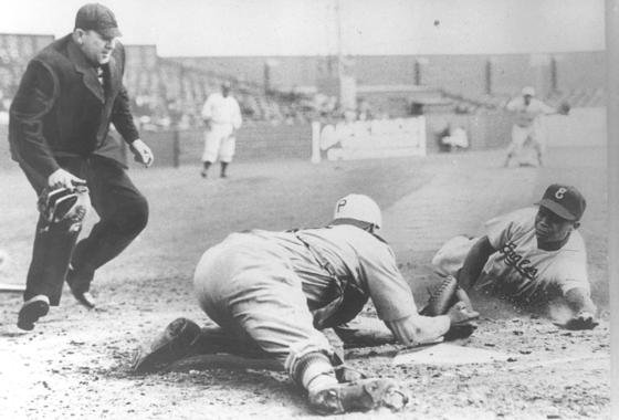 Larry Doby slides home as a member of the Newark Eagles during a Negro Leagues game against the Philadelphia Stars in 1946. (Larry Hogan Collection / National Baseball Hall of Fame and Museum)