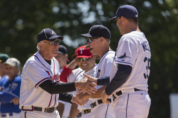 Phil Niekro (left) greets members of Team Knucksie, including Alan Trammell (center), before the 2015 Hall of Fame Classic Game in Cooperstown. (Jean Fruth/National Baseball Hall of Fame and Museum)