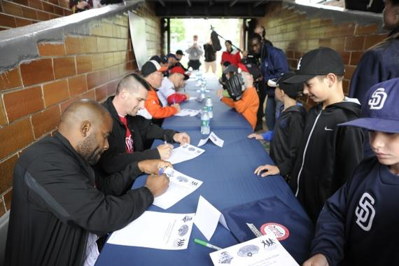 Participants collect autographs from Classic participants following last year's clinic. (Milo Stewart Jr,/National Baseball Hall of Fame)
