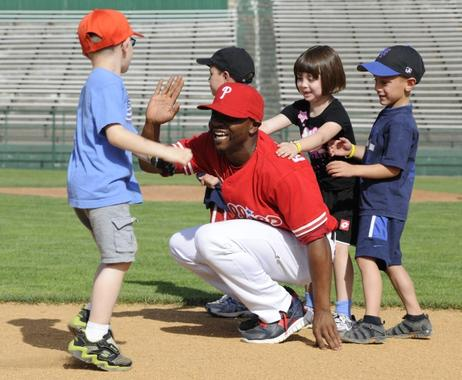 Participants high five players during the Cooperstown Classic Clinic. (Milo Stewart Jr./National Baseball Hall of Fame)
