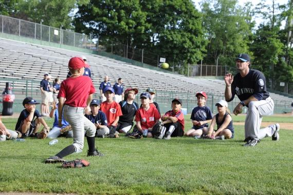 Youth practice throwing at the Cooperstown Classic Clinic. (Milo Stewart Jr./National Baseball Hall of Fame)