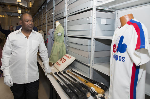 Tim Raines checks out various artifacts preserved at the Hall of Fame, including former teammate Andre Dawson's Expos jersey. (Milo Stewart Jr. / National Baseball Hall of Fame and Museum)