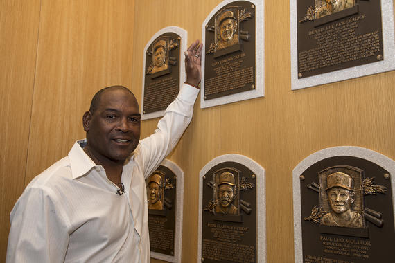Tim Raines poses next to former Expos teammate Gary Carter's plaque at the Hall of Fame. (Milo Stewart Jr.  / National Baseball Hall of Fame and Museum)