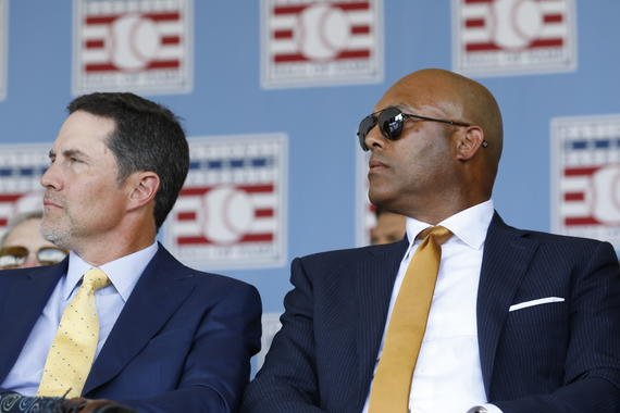 Class of 2019 Hall of Famers Mike Mussina and Mariano Rivera watch a TV monitor on stage during the 2019 <em>Induction Ceremony.</em> (Milo Stewart Jr./National Baseball Hall of Fame and Museum)