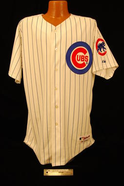 Wearing this Cubs jersey on July 26, 2005, Greg Maddux fanned the Giants' Omar Vizquel to end the third inning and log his 3,000th career strikeout. That made Maddux just the ninth pitcher to combine that milestone with 300 wins - BL-172-2005 (Milo Stewart Jr./National Baseball Hall of Fame Library)