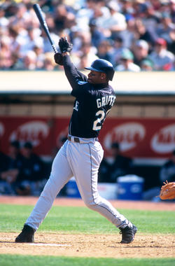 Ken Griffey Jr. of the Seattle Mariners bats during a game against the Oakland Athletics at the Oakland Coliseum in Oakland, California in 1999.  (Brad Mangin / National Baseball Hall of Fame Library)