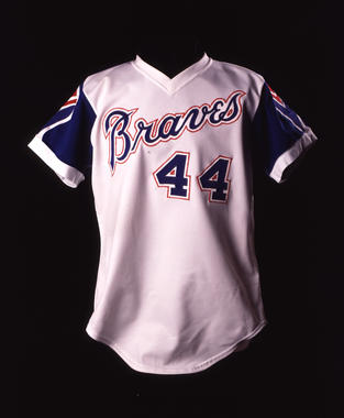 Atlanta Braves home uniform shirt #44 worn by Hank Aaron on April 8, 1974 when he broke Babe Ruth's career home run record with his 715th homer in the 4th inning vs. Los Angeles Dodgers - B-5.87  (Milo Stewart Jr./National Baseball Hall of Fame Library)