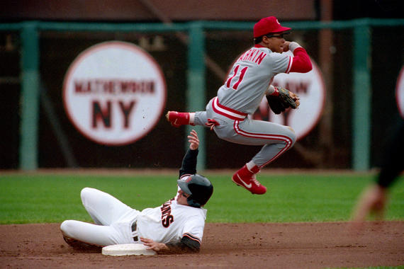 Barry Larkin of the Cincinnati Reds turns a double play at second base during a game against the San Francisco Giants at Candlestick Park in San Francisco, California in 1990. (Brad Mangin/National Baseball Hall of Fame Library)