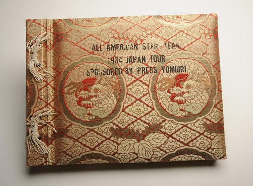 Cover of the photograph album presented to participants in the 1934 American baseball tour to Japan by the tour's sponsor, the Yomiuri newspaper. - B-277-51 (Milo Stewart, Jr./National Baseball Hall of Fame Library)