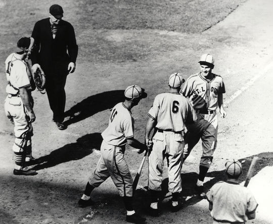 George McQuinn of the St. Louis Browns is congratulated by teammates Mark Christman (6) and Gene Moore (15) after hitting a two-run home run in the fourth inning of Game 1 of the 1944 World Series. That year's Fall Classic was enjoyed by millions of soldiers around the world via radio broadcasts. (National Baseball Hall of Fame and Museum)