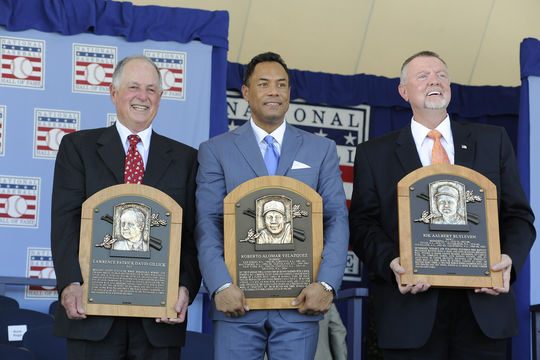 From left to right: Pat Gillick, Roberto Alomar and Bert Blyleven pose with their plaques during the 2011 Induction Ceremony. (Milo Stewart Jr./National Baseball Hall of Fame and Museum)