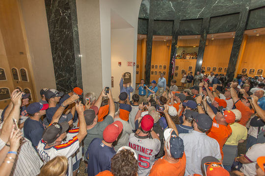 Fans eagerly take their first look at the new plaques for the Class of 2015 during Hall of Fame Weekend. (Jean Fruth / National Baseball Hall of Fame)