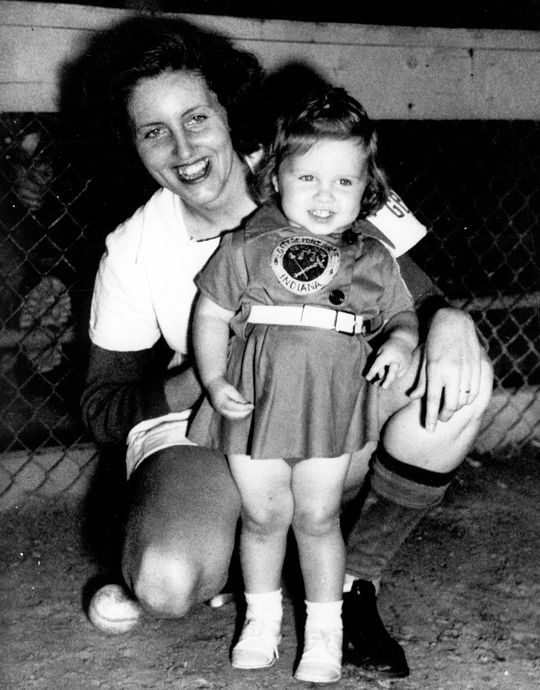 "A photograph taken in 1950 of Dottie Collins and her daughter, Patty (19 months), dressed in matching Fort Wayne Daisies uniforms.  <a href""http://collection.baseballhall.org/islandora/object/islandora%3A503804"">PASTIME</a> (National Baseball Hall of Fame and Museum)"