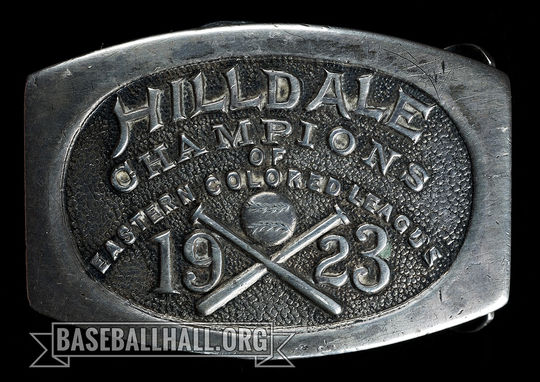 "The Hall of Fame's collection includes a sterling silver belt buckle awarded to the members of the 1923 Hilldale club to celebrate their pennant-winning season in 1923. <a href=""https://collection.baseballhall.org/PASTIME/hilldale-colored-leagues-champion-belt-buckle-1923-2"">PASTIME</a> (Milo Stewart Jr./National Baseball Hall of Fame and Museum)"
