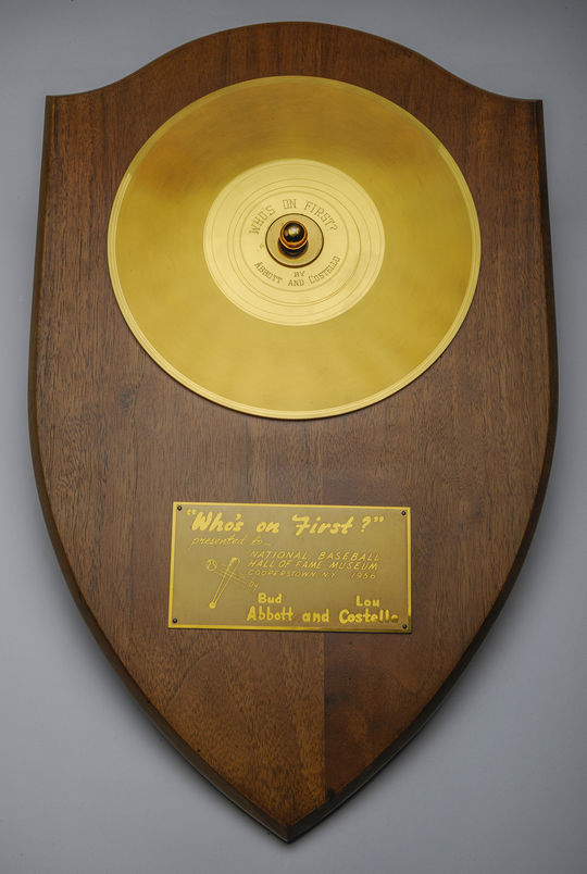 "The gold record Abbott and Costello received for their recording of ""Who's On First"" hangs in the Museum's Library in Cooperstown. (Milo Stewart Jr./National Baseball Hal of Fame and Museum)"