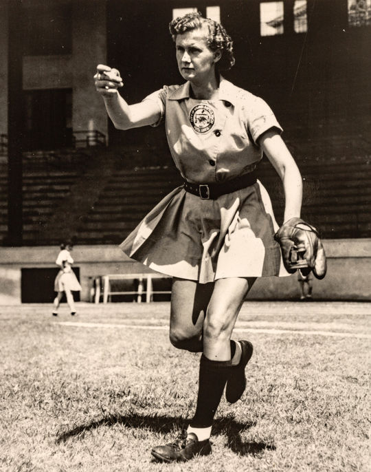 A photograph depicting Connie Wisniewski's underhand pitching follow through. (National Baseball Hall of Fame and Museum)