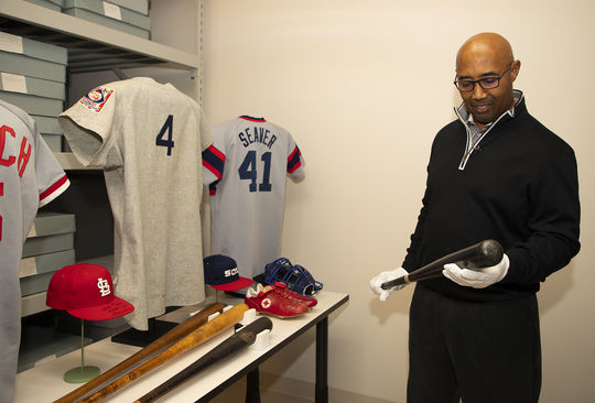 Harold Baines holds the bat he used to hit a home run to end the longest game in American League history on May 9, 1984. Baines toured the Hall of Fame on Jan. 29 in preparation for his Hall of Fame induction in July. (Milo Stewart Jr./National Baseball Hall of Fame and Museum)