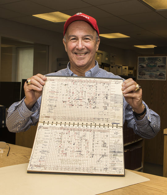 Bill George holds the score book he donated to the Hall of Fame following the longest game in professional baseball history in 1981. (Milo Stewart Jr./National Baseball Hall of Fame and Museum)