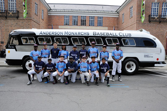 The Anderson Monarchs Baseball Club poses for a shot in front of their bus parked at the Museum's entrance. (Milo Stewart, Jr. / National Baseball Hall of Fame)