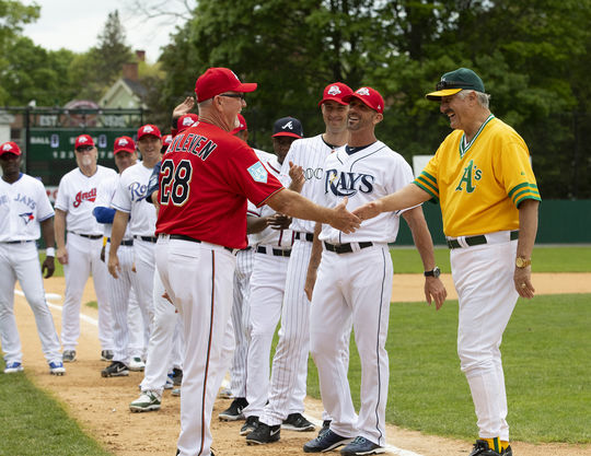 Hall of Famers Bert Blyleven and Rollie Fingers shake hands before the May 25, 2019, Hall of Fame Classic. (Milo Stewart Jr./National Baseball Hall of Fame and Museum)