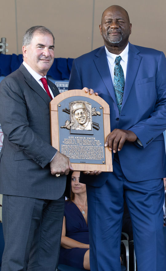 Lee Smith holds his Hall of Fame plaque with Hall of Fame President Tim Mead at the 2019 Induction Ceremony on July 21 in Cooperstown. (Amity Photos)