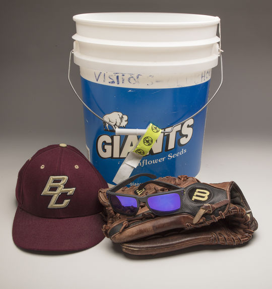 Pete Frates recently donated a cap and glove from his playing days at Boston College and the ice bucket and sunglasses he used for his Ice Bucket Challenge at Fenway Park in 2014. (Milo Stewart Jr. / National Baseball Hall of Fame and Museum)