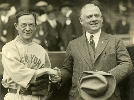 New York Yankees manager Miller Huggins (left) and New York Giants manager John McGraw shake hands during the 1923 World Series. The two skippers won a combined six World Series championships during their Hall of Fame careers. BL-1515-68WT (National Baseball Hall of Fame Library)